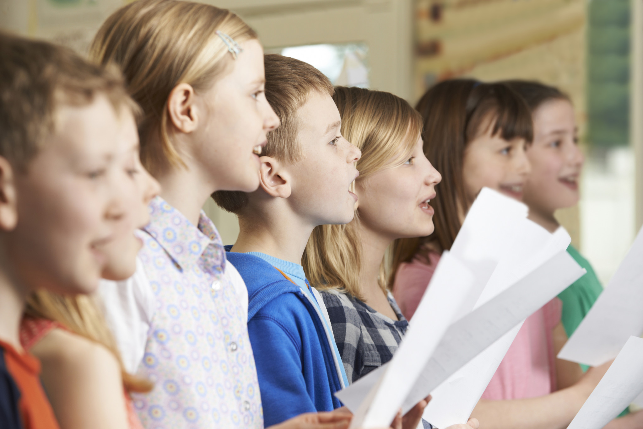 Group Of School Children Singing In School Choir ** Note: Shallow depth of field